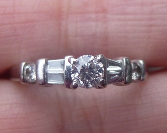 1940s 54 point total weight baguette and round diamond platinum engagment ring