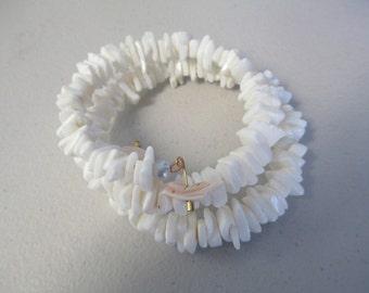 Handmade Sea Shell memory wire bracelet with shell bird ends. ooak