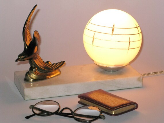 French art deco bird lamp on a marble plinth