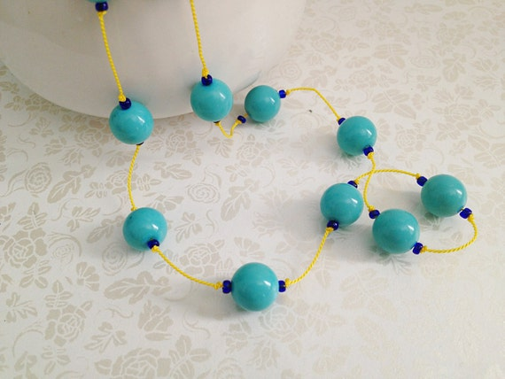 Hand-knotted Vintage Aqua Beaded Necklace on Yellow Silk Cording. Long Necklace. Double Stranded. Bright. Turquoise. Cobalt Blue.