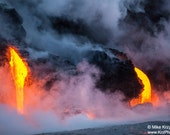 A Glowing Stream of Lava Flows into the Ocean at Kalapana on the Big Island in Hawaii