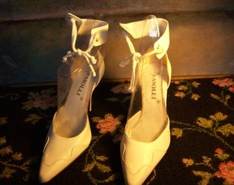White heels with ankle tie by RASOLI