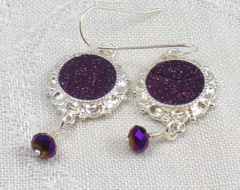 Earrings: glittery purple resin in silver bezels