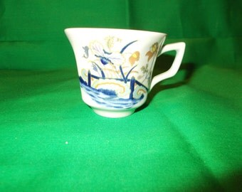One (1), Demitasse Cup, from Wedgwood, in the Lotus Pattern.