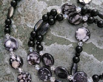 Shell Necklace black handmade beadwork strand swarovski crystals black glass long strand beaded necklace