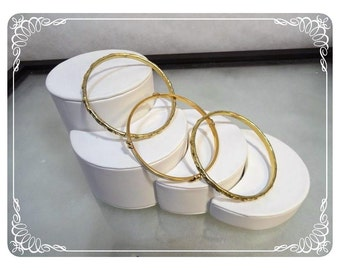 Three Vintage Bangle Bracelets - Two Gold Tone & 1 White Monet Enamel   1303a-120312000