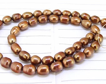 One Full Strand--- Rice Coffee Pure Freshwater Pearl----6mm-7mm----about  45 Pieces----15.5 inch strand