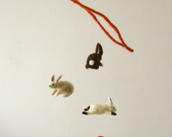 flying rabbits catching carrots - decorative mobile - needle felted