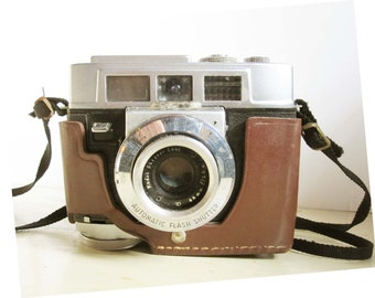 A Kodak Motormatic 35F Camera With Its Black Synethic Strap and Leather Body Cover - Made in the USA