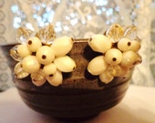 Vintage white and clear beaded clip earrings.