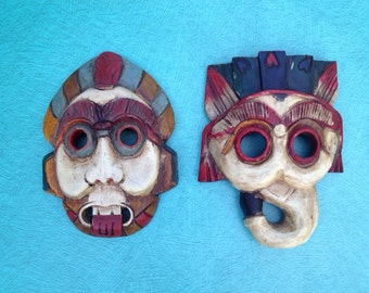 Pair of hand carved masks made in Thailand