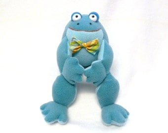 Plush frog toy with striped bow tie