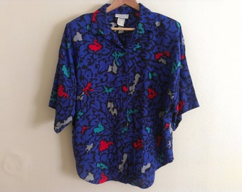 80s vintage women's extra large XL short sleeve colorful animal pattern blouse, missing one button, has shoulder pads