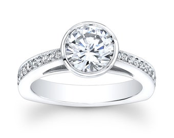 Ladies 18kt white gold vintage engagement ring with 1ct Round White Sapphire Center and 0.25 ctw G-VS2 pave diamonds