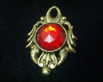 Vintage gold tone and red plastic center dress or scarf clasp