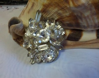 Beautiful handmade brooch set with silver tone metal and shiny crystals