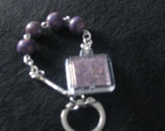 Memory beads with a compartment of dried flowers from loved ones funeral.