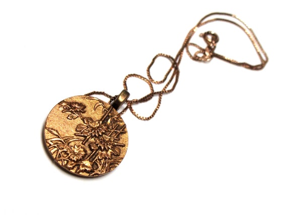 Asian theme necklace pendant with bamboo and flowers