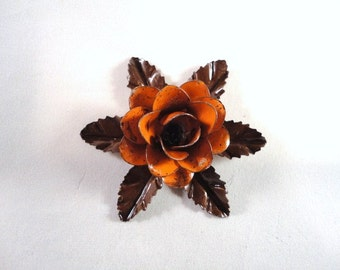 Small Size Decorative Metal Hand Cut and Hand Painted Rustic Orange Rose Mounted on a Bed of Metal Leaves.