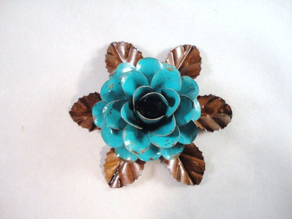 Medium Size Decorative Metal Hand Cut and Hand Painted Rustic Turquoise Rose Mounted on a Bed of Metal Leaves.