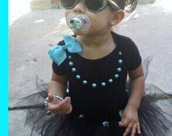 Audrey Hepburn Birthday, Tutu, Onesie Or Tee, Tiffany Pearls, Tiffany Bow.. This Outfit comes in size 9mos to 24 mos and 2T- 10