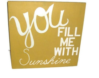 Yellow and white You fill me with Sunshine sign