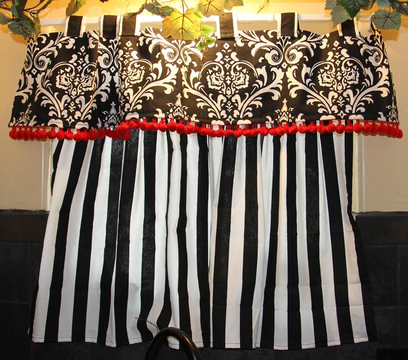 Bold black and white kitchen curtains with red details Bold black and white striped curtains