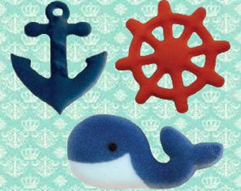 Nautical Edible Sugar Assorted Dec-ons-Packaged in a set of 12, 4 anchors, 4 steering wheels, and 4 whales.