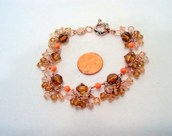 Vintage Givenchy charm bracelet, Stunning Sparkly Crystal Bead charms and peach beads, rose gold finish Signed Designer Jewellery