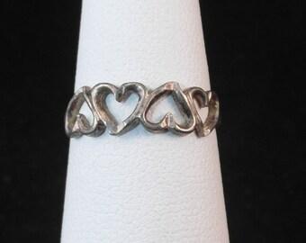 Dainty Little Four Heart Ring in Sterling Silver