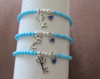 Turquoise bracelet with 2 charms