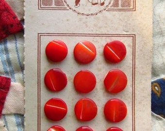 Orange/red vintage buttons on card
