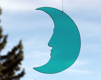 Crescent Moon ... Man-In-The-Moon, teal-blue glass