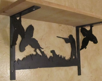 Metal Art shelf protraying a hunter shooting a pheasant with his dog