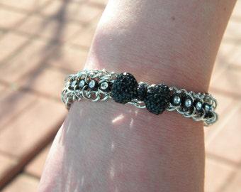 Chain and rhinestone bracelet.