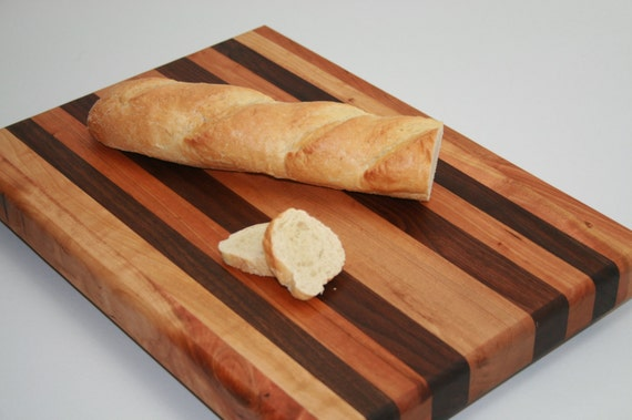 J.K. Adams Large Rectangle cutting board is made from ash with their exclusive driftwood teak oil finish. This generously sized board captures the natural beauty of the wood .