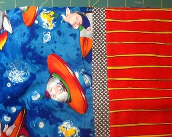 Pigs in space. Flying saucers. Standard pillowcase.  Bright blue and orange, with orange striped cuff and patterned trim