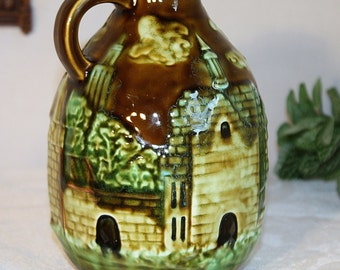 Pottery bottle with city scape, made in Japan