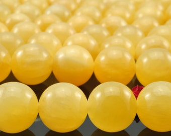 32 pcs of Yellow Jade smooth round beads in 12mm