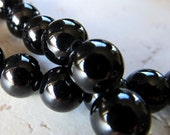 Ebony Black Spinel Smooth Round Beads - Lustrous Black 8mm AA Grade - 8 inch Strand