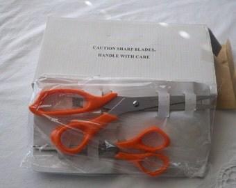 Set of Three Titanium Scissors One multi-blade