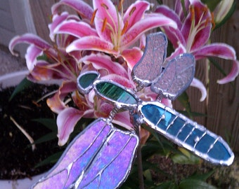 Garden stake dragon fly with animated, moveable wings.