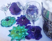 Great accessory for your table or party - the wine coaster that stays on stemware