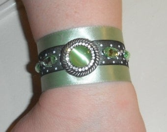 Ribbon cuff bracelet in pale sage green with rhinestones and buttons