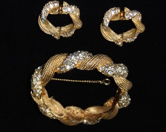 signed hattie carnegie bracelet and earring set.