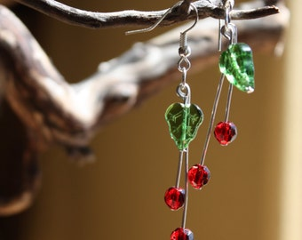 Glass Cherry dangling earrings topped with a green glass leaf.