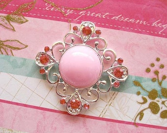Charming Pink Rhinestone Embellishment great for hair charms and pins, making jewelry, brooches, and other DIY projects