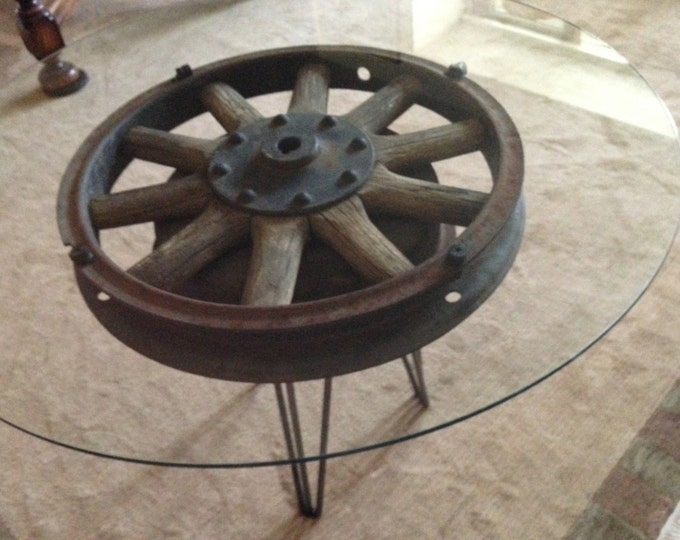 "Antique wooden 18 inch truck wheel accent table  with 30"" diameter glass top"