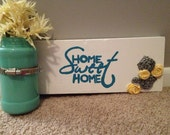 5 DOLLARS OFF - Teal painted jar mounted on 'Home Sweet Home' painted wood with fabric flowers