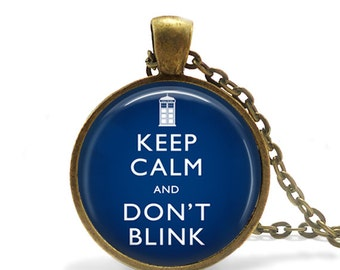 Keep Calm and Dont Blink Bronze Glass Pendant